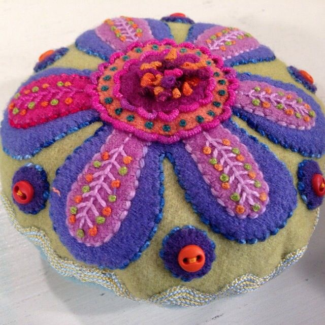 Sue Spargo Pin Cushion. Saw this lady, Sue Spargo, make this beautiful pin cusion on Quilting Arts TV. She is amazing in the various stitches she makes. I can't do hand work (because of my carpal tunnel), so I'm looking to see where I can buy a cushion like this. Wool is BEST for a pin cushion because the lanolin in the wool coats and protects needles (from rust).