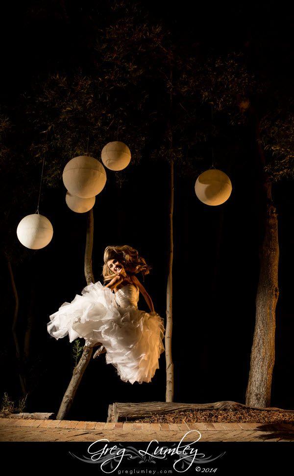 Bride jumping in air at night.  Wedding photos taken at night.  Night shoot by wedding photographer Greg Lumley.