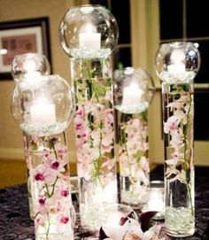 D I Y Wedding Centerpiece Glass Vases Filled With Water And Orchids Topped Candle Rose