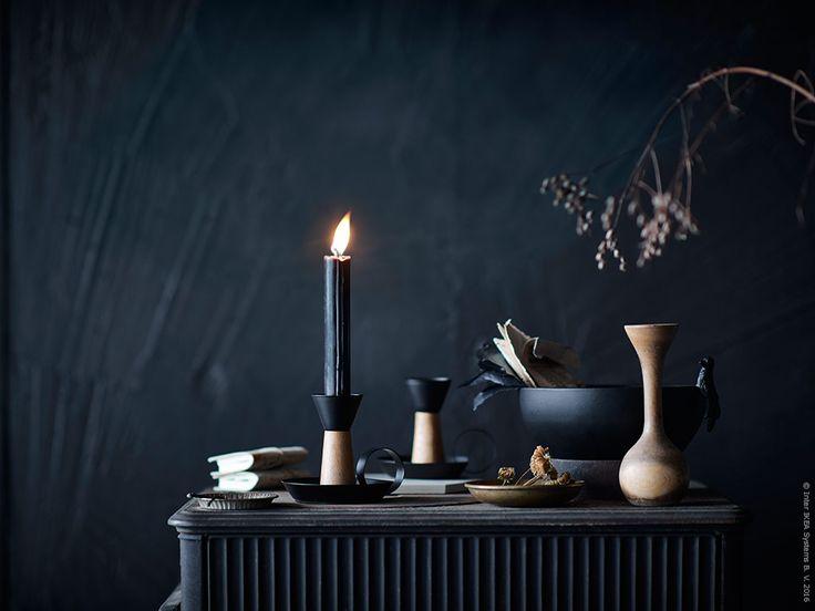 ÄNDLÖS är en modern variant av en traditionell ljusstake där lackat stål står i kontrast mot akacia.