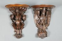 "Lot 150s A pair of 19th Century Black Forest carved oak wall brackets decorated with exotic birds on fish 15""  £300-500"