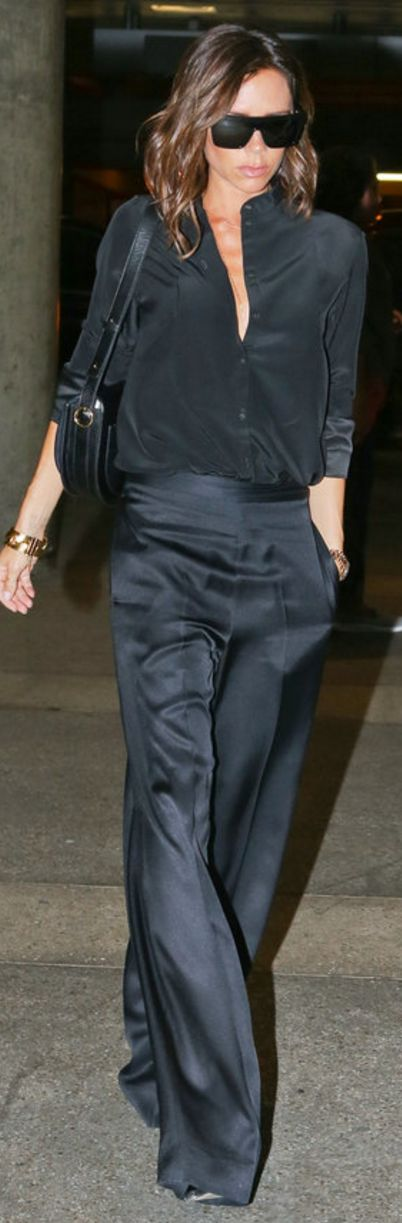 Who made  Victoria Beckham's black sunglasses, button down shirt, wide leg pants, sunglasses, and handbag?