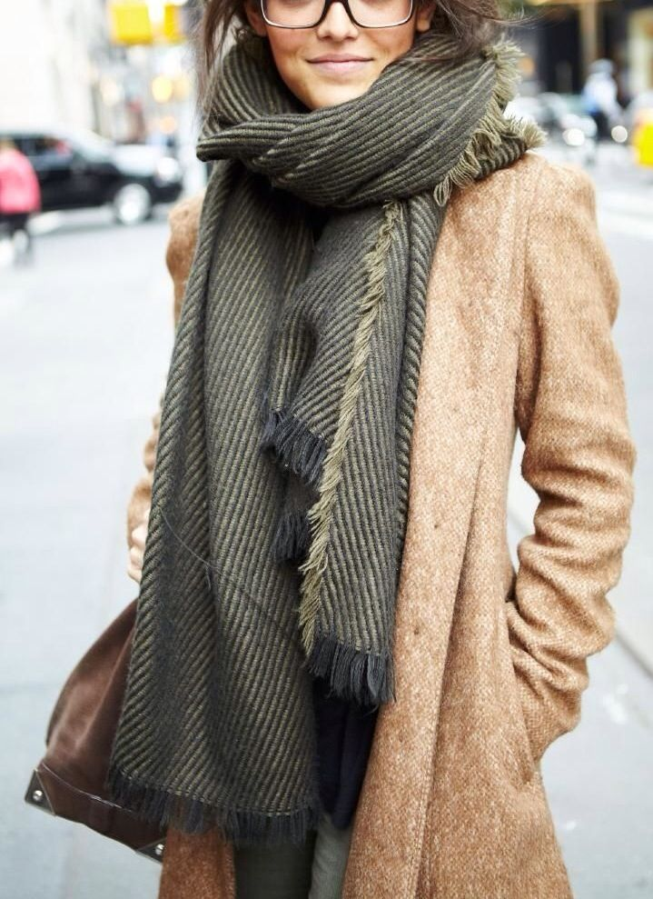 Green-ish scarf on a camel coat. Beautifully combined