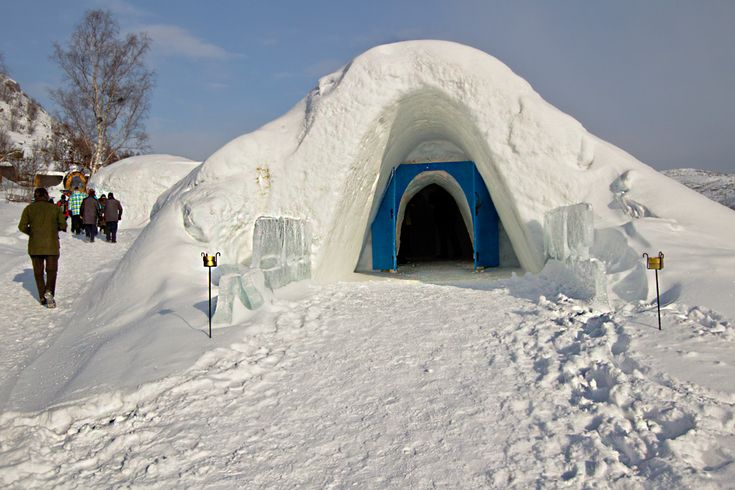 The Snow Hotel in Kirkenes Norway features ice beds, sculptures, and the largest ice bar in the country