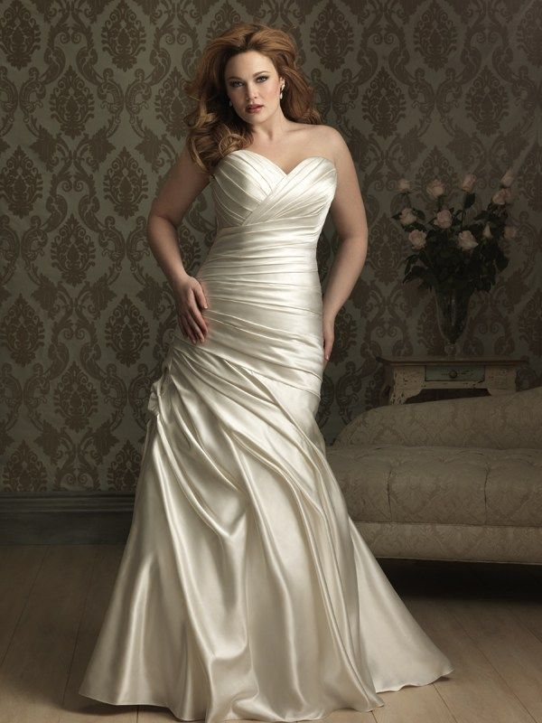 W284  Allure Women Bridal Gown - Simple and sophisticated. This stunning wedding dress is created from soft satin. The sweetheart neckline is flattering while ruching continues throughout. A lace-up back ensures a perfect fit.