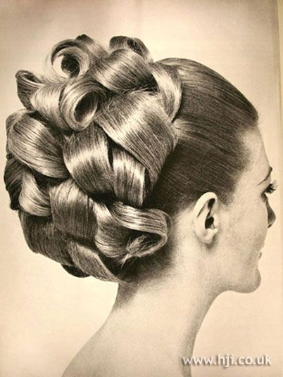 1969 updo curls hairstyle    Long hair was pulled back to the crown and sections were barrel curled     Hairstyle by: Francis of John  Location: London