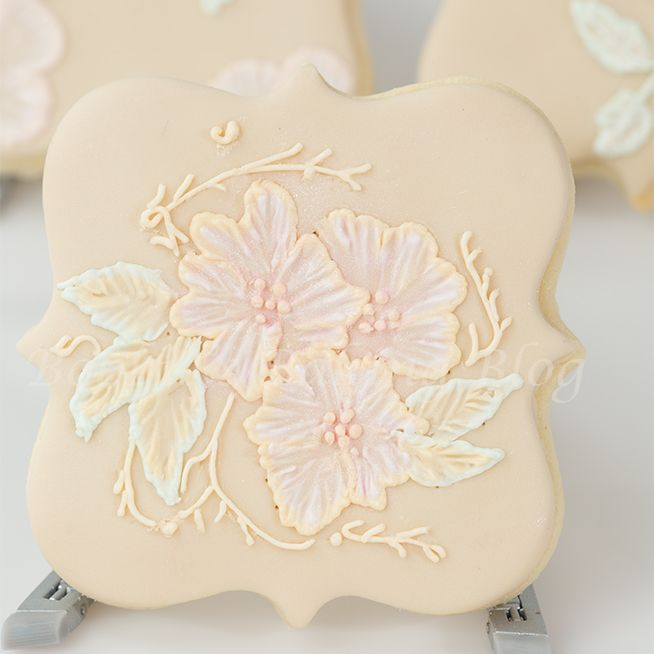 Victorian Two Tone Brush Embroidery: An elegant sugar cookie decorated with victorian royal icing brush embroidery