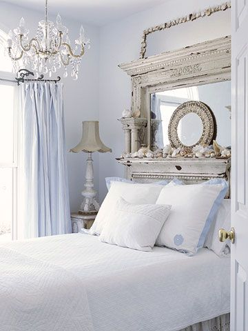 Bedroom 4 - My daughter's room is lovely and designed for a young lady. The soft blue + white is a contemporary palette.  The weathered mantle repurposed into a mirror and used as a headboard and another as a shelf for beautiful knick-knack memories. The crisp white matelasse bedcovering and the petite crystal chandelier are charming. #bhg.com @katerinamaslaro