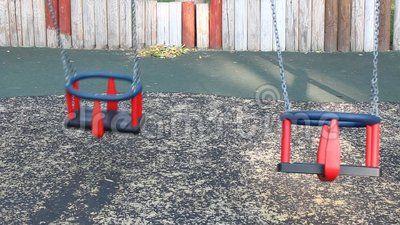 Two swing seats - swinging at playground.