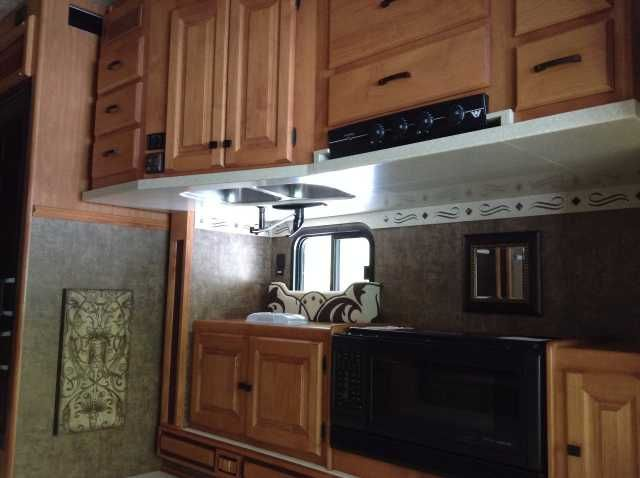 2012 Used Tiffin Motorhomes Allegro 35QBA Class A in Florida FL.Recreational Vehicle, rv, 2012 Tiffin Motorhomes Allegro 35QBA, This is a very clean well kept RV made for a family. Owned by non smokers and has been well maintained. A great feature of this rv is the bunk beds near the back of the coach. This keeps you from needing to make the sofa bed or kitchenette bed everyday for the kids. The sofa couch includes an air inflated mattress for extra comfort. The kitchenette also will fold…