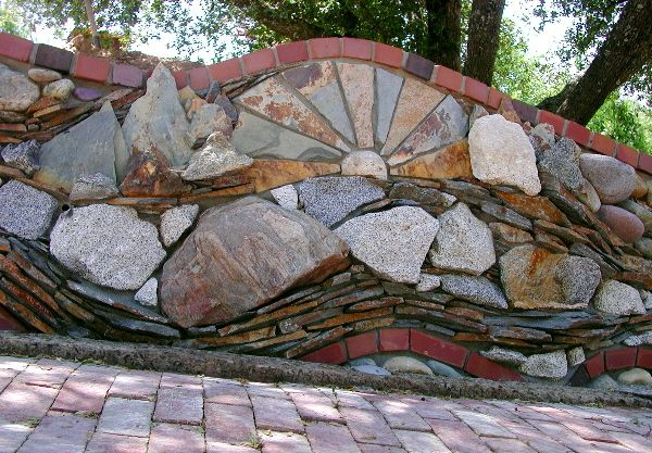 SLATE, BRICK, RIVER ROCK, LEDGER STONE, GRANITE    A retaining wall that says it all