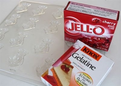 Homemade Gummi Candy  -  similar idea, maybe use a silicon mold and homemade fruit roll-up recipe to create shaped fruit