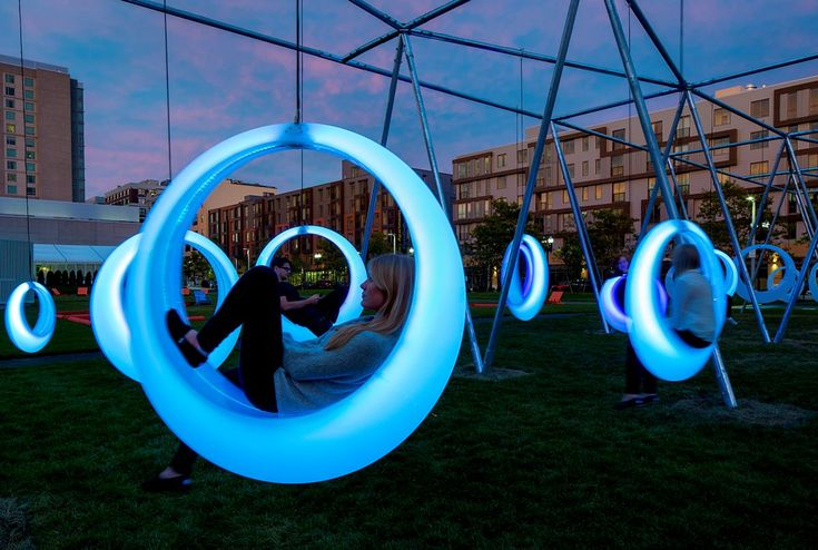 Höweler + Yoon Architecture have created an interactive playscape composed of 20 illuminated ring-shaped swings. The installation is located at The Lawn on D in Boston, Massachusetts and will be on display until October 31st.