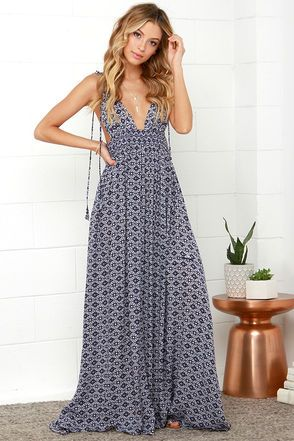 If sandy beaches are what you seek, let the Field Day Navy Blue Print Maxi Dress be your guide! This sun-ready maxi starts with dual tying spaghetti straps that top a plunging V front, matching back, plus deep arm openings and a smocked waist. The woven navy blue and ivory print fabric cascades into an elegant maxi skirt for a positively breezy look. Bodice is lined. 100% Rayon. Hand Wash Cold. Imported.