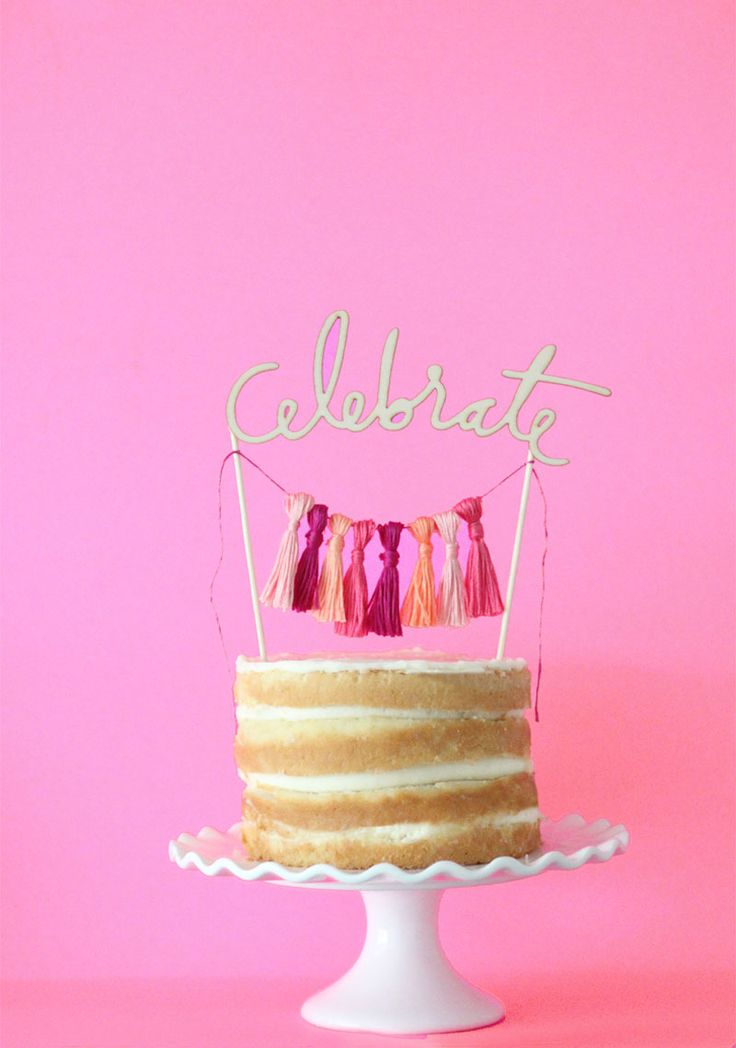 Make this DIY wedding cake topper for less than $5! It's the perfect celebrate cut out topper and is super easy to create! You just need to thread for the tassels, skewers & your wooden cut out!