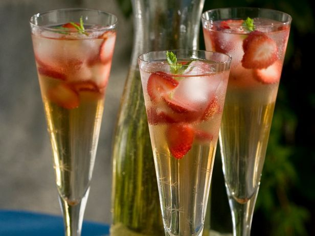 Cava Sangria : Bobby combines white grape juice, brandy and sliced strawberries to create a lighter twist on sangria. Finish the drink with cava, a Spanish sparkling wine.