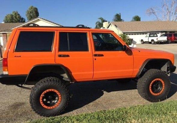 Image result for orange jeep xj