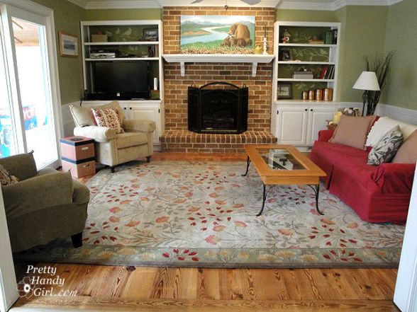 Living Room With Brick Fireplace cozy rustic living room, antique heart pine floors, painted brick