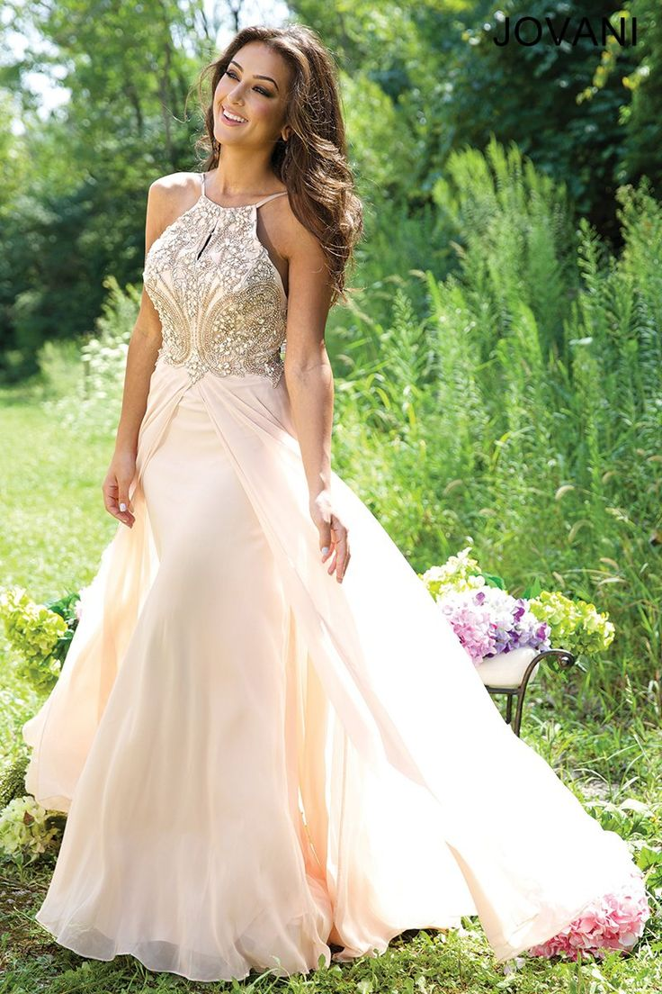 Beautiful sleeveless chiffon dress features a keyhole neckline and beaded bodice