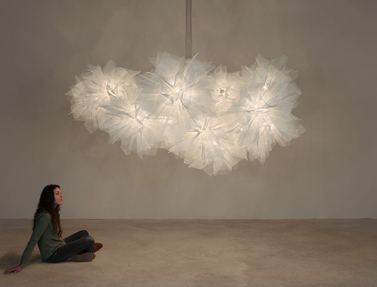 This almost cloud-like chandelier is made from galvanized painted steel. #lighting