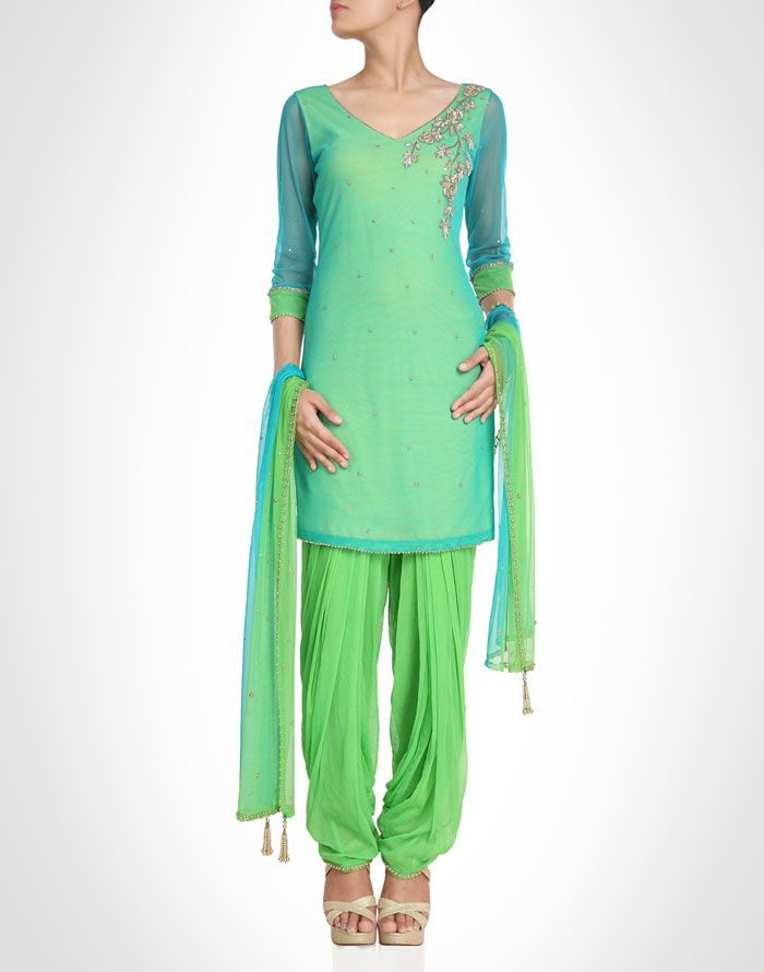 Green suit embellished with sequin detailing epitomizes lady like grace. Shop Now: www.kimaya.in