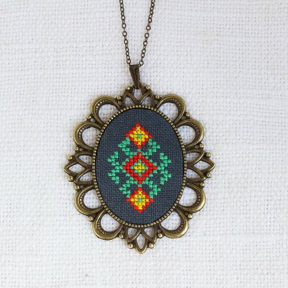 If you love ethnic pieces and unique jewelry, youll adore this stylish Ethnic hand-embroidered necklace. With a special vintage look, it becomes a wonderful addition to your everyday outfit. Wearing this necklace, youll receive a whole raft of compliments!  The necklace is made with hand dyed linen fabric with cotton embroidery floss.  • Pendant is 5.2 cm x 6 cm (2 x 2 2/8) • Embroidered piece is 3 cm x 4 cm (1 2/8 x 1 5/8) • Default length of chain is 55 cm / 22. • All findings are bronze…
