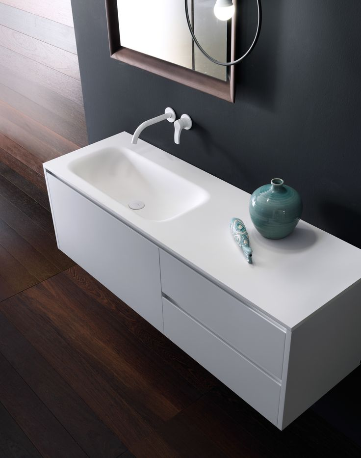 Simple forms capable of redesigning space. VIAVENETO|G unit with three drawers with grooved handle in matt White lacquered finish and top featuring ROUND SOFT integrated washbasin in Cristalplant Biobased. Follow us on it.pinterest.com/falperdesign