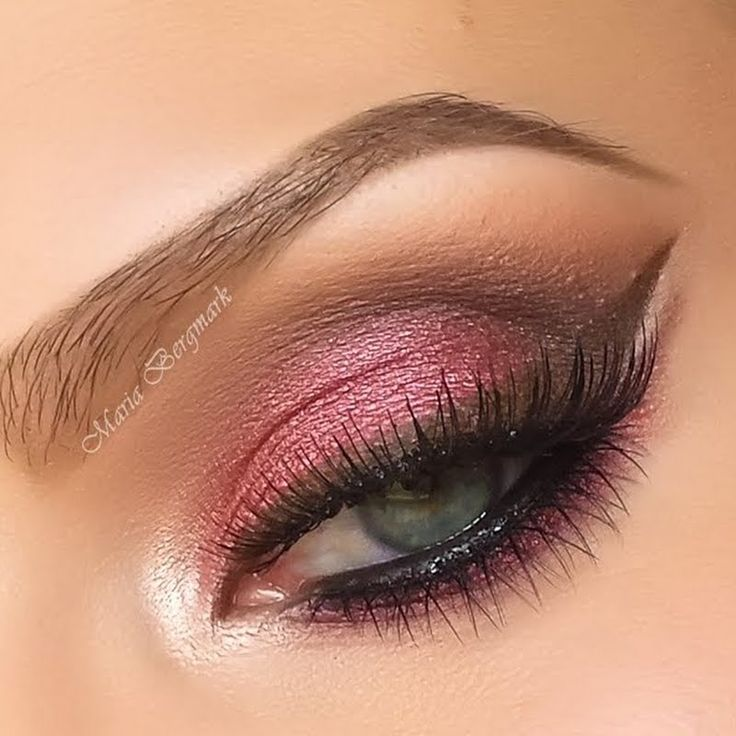 A rich cranberry colored eyeshadow in a frosted finish is used all over the lids. Brown hues are added to the crease for definition. Follow the detailed how-to and to recreate for your next night out.