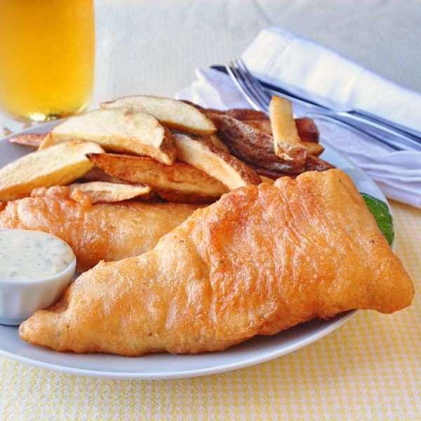 Super Crispy Fish and Chips - the recipe with all the crunch! Learn the secret to getting the perfect batter on this pub food classic.