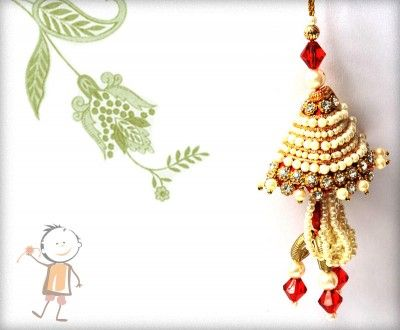 Lumba Rakhi - Send Online #Lumba #Rakhi – online rakhi. Unique Red Crystals and Pearls Lumba, surprise  your loved ones with roli chawal, chocolates and a greeting card as it is also a part of our package and that too without any extra charges. http://www.bablarakhi.com/