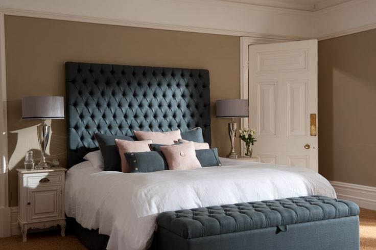 Diamond tufted (chesterfield style) headboard and matching storage ottoman