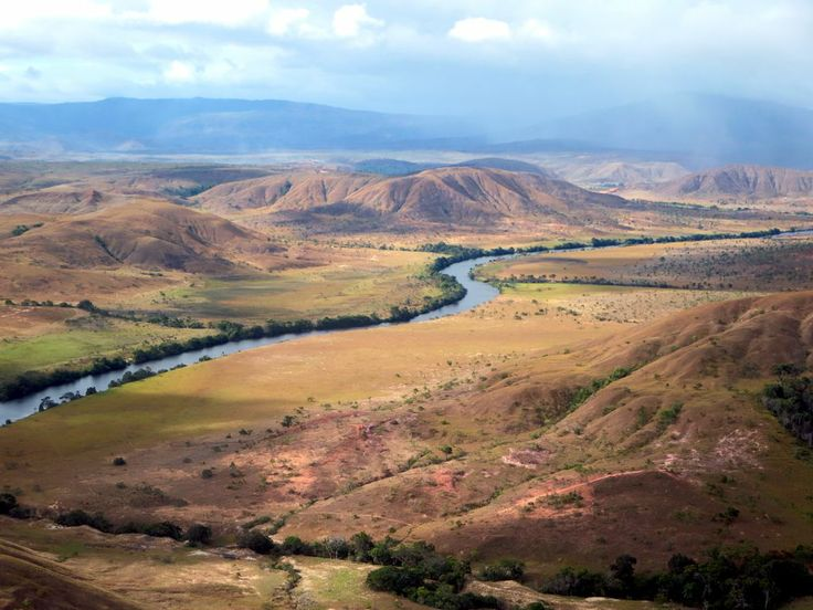 The Ireng River (Rio Mau) marks the border between the rolling grasslands of southwestern Guyana and those of northern Brazil.