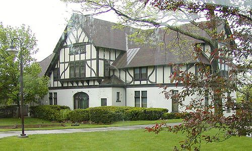 Tudor Style House - Medieval flavor.  The Tudor style is sometimes called Medieval Revival.  1890 to present.