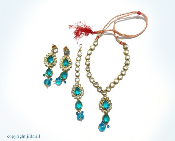 Bright turquoise blue stones with sparkling white Kundans give a very radiant look for any occasion.