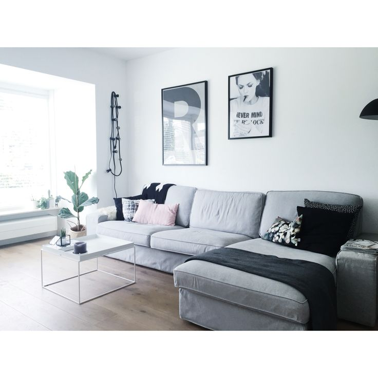 Our living room with lots of white, black and grey toned details. Couch: Ikea Kivik • Coffee table: Hay Tray table • Print: Playtype • Cushions: Ikea, House doctor and Hinck Amsterdam