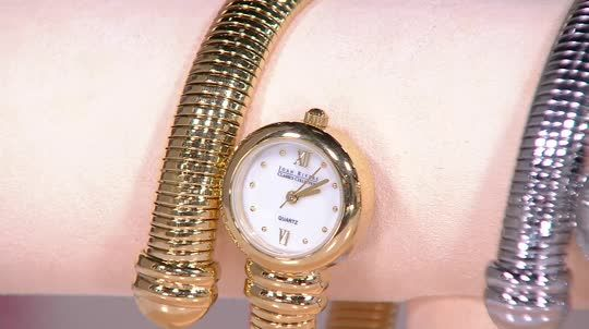 Wrapper's delight. Fashionable and functional, this Joan Rivers tubogas coiled wrap watch curves elegantly around your wrist, leading to a sleek round, mother-of-pearl dial for a classic and clean look. QVC.com