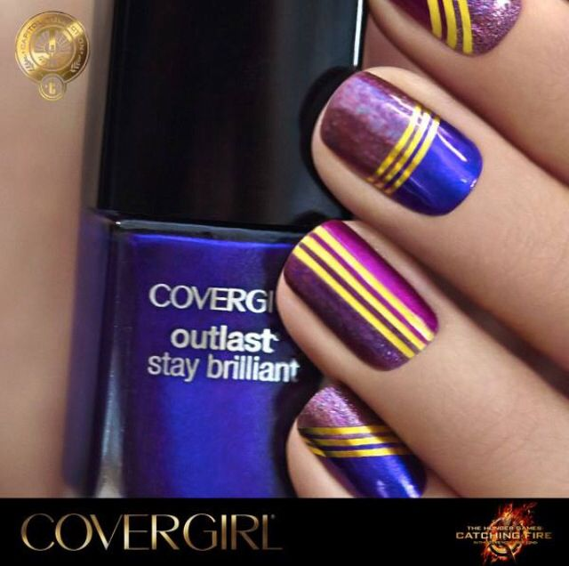 Catching Fire Hunger Games nails Covergirl Purple blue and gold nail polish Striped nail decal accent