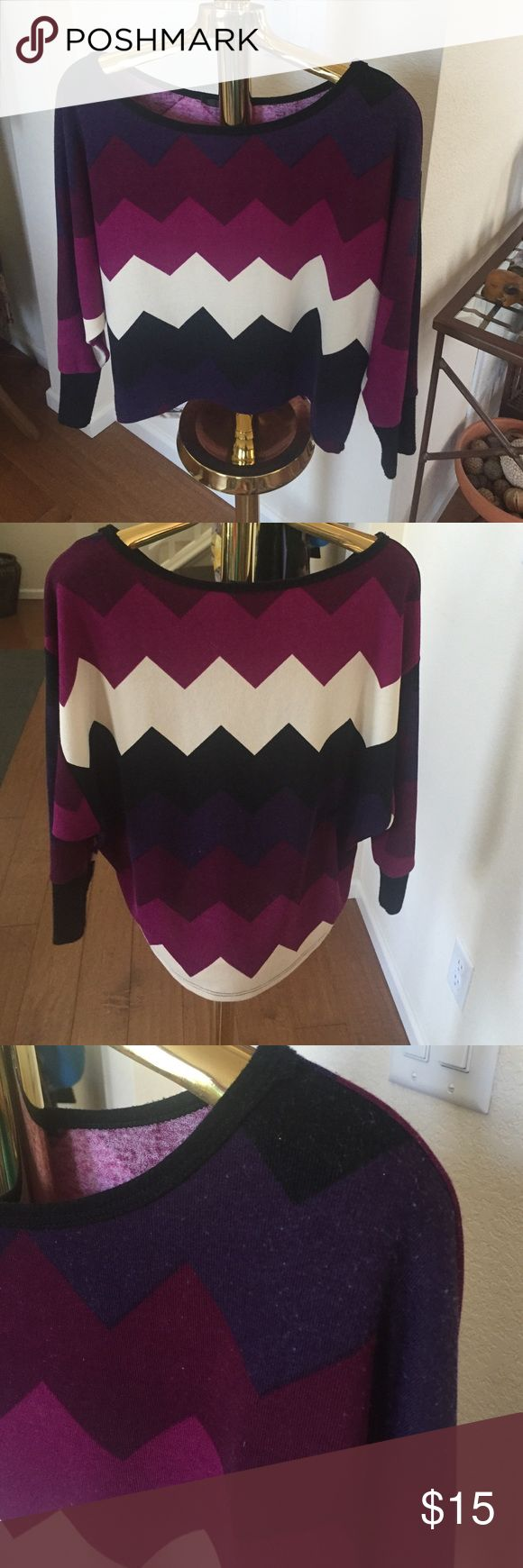 "Fun Aztec Design Sweater Shirt MCM- Small Multi-colored sweater shirt. Shorter in front and longer in back. 3/4 sleeve. Good condition with signs of wear shown in pic. 17"" from front collar to waist and 22"" in back. Poly Rayon Spandex blend. MCM Sweaters Crew & Scoop Necks"
