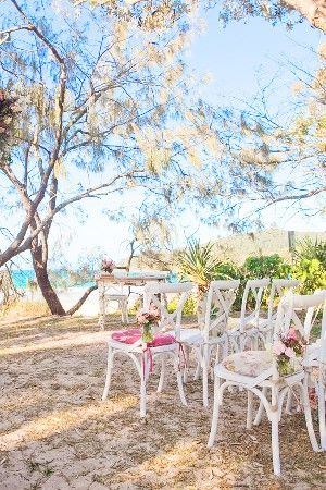 White East Hampton Chairs with floral cushions #lovebirdweddings #weddingchairs #white