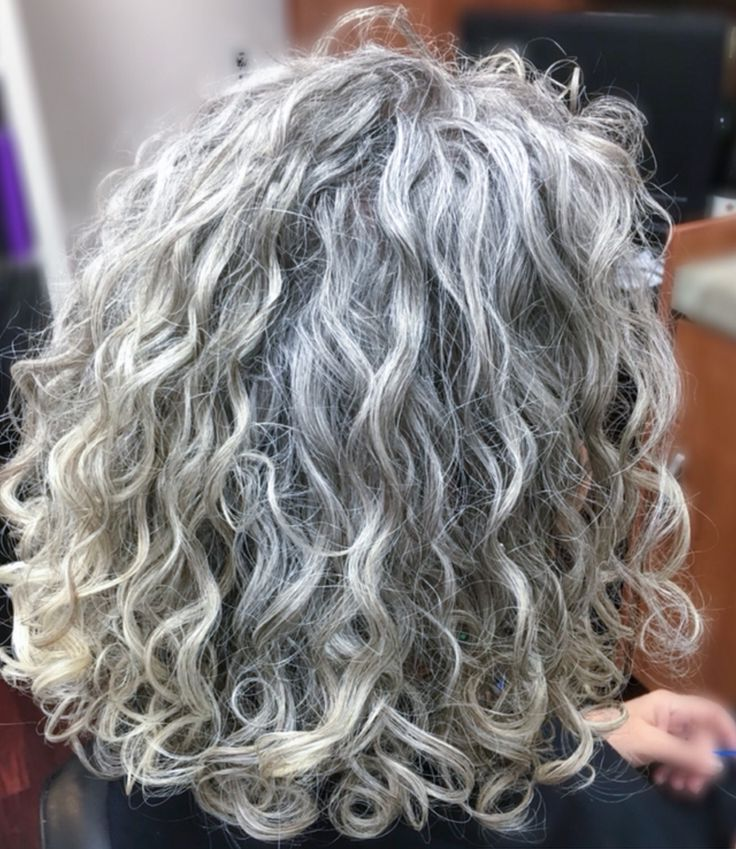 Thick, wavy, curly natural grey hair. I love the colour and texture of her hair.