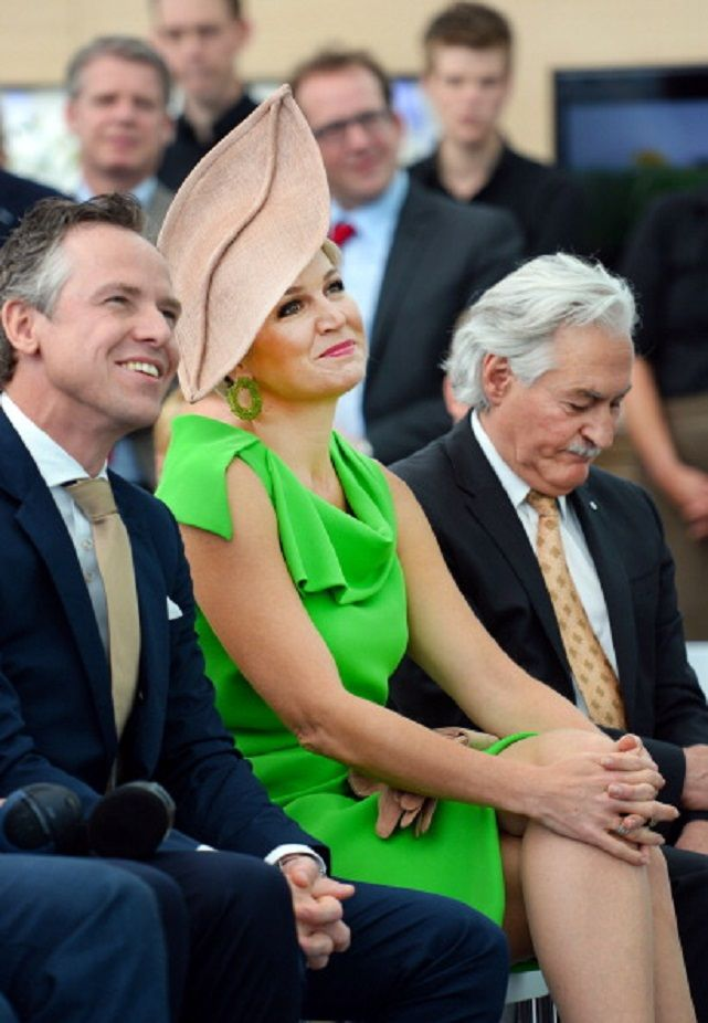 Dutch Queen Maxima (C) and Gerben Bouwmeester (L) director of Unipro BV, sit during the opening of a new building of Unipro, a producer and supplier of floor systems, in Haaksbergen, eastern Netherlands, on 16.05.2014