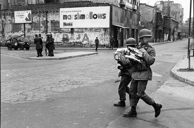 David Burnett. In the aftermath of the coup, soldiers carry away allegedly subversive books, which will be burned. Santiago, Chile, September 1973