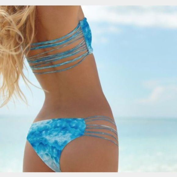 Mikoh Swimwear Kapalua Bottom in Blue Snake These bottoms are so cute! Previously worn but still in perfect condition - no fading and no stains. Cheeky fit! Stretchy material. The blue snake print is to die for. Open to trades and offers! I can post picture of the actual bottoms/model them if requested. Mikoh Swim Bikinis