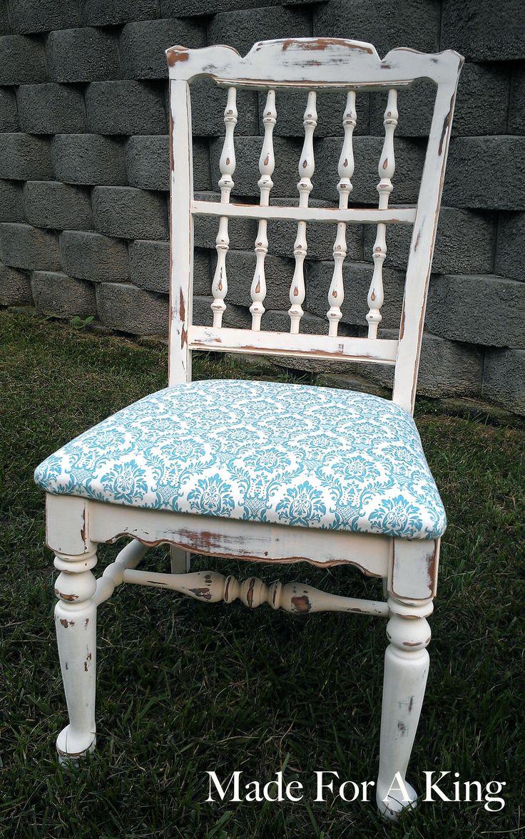 Distressed chair with a cute print cushion