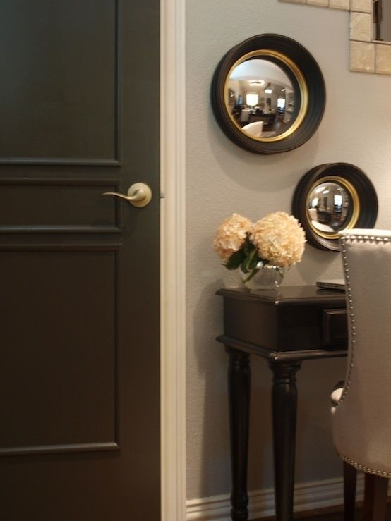 Chocolate brown doors (Benjamin Moore Dragon's Breath) with white trim.
