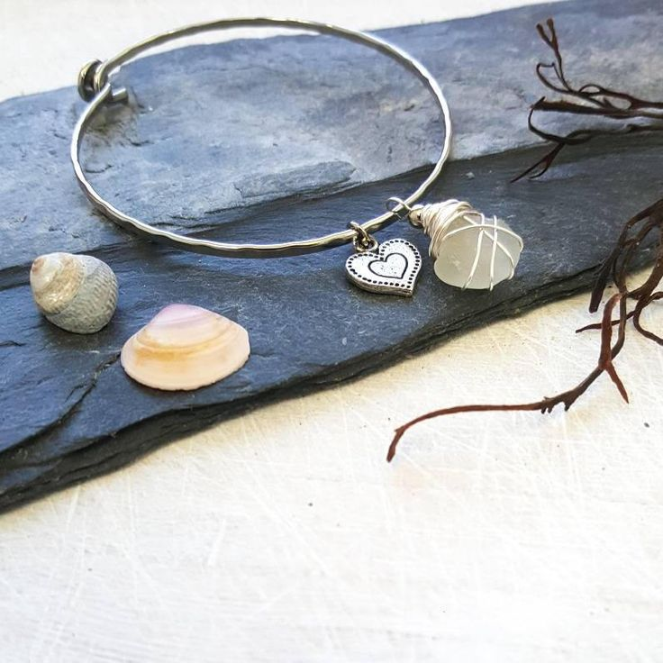 This boho heart bangle oozes beachy charm! A love bangle with seaglass and a sweet heart charm. Romantic and earthy. I know that so many people, like me, feel the call of the sea and the salty breeze in their soul. My aim is to bring a little slice of that romantic ocean escape to my customers �
