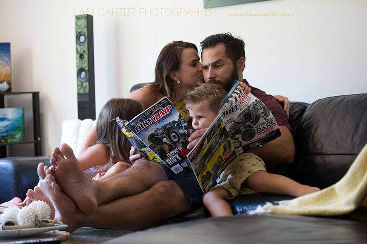 Family sitting on the couch together reading car magazines. Lifestyle photography. www.lanicarter.com