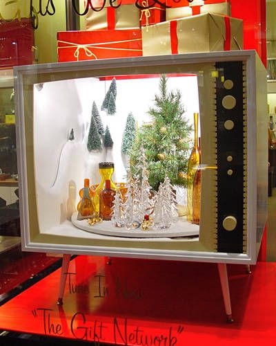 2012 HOLIDAY WINDOWS: GUMP'S SAN FRANCISCO    A music box in the shape of a 1960s television set provided the inspiration for Gump's holiday windows this year. The nearly 150-year-old San Francisco department store was so enamored of the music box—which came from its holiday gift collection—that the store's visual display team created television-like display cases in which vignettes of merchandise sit.
