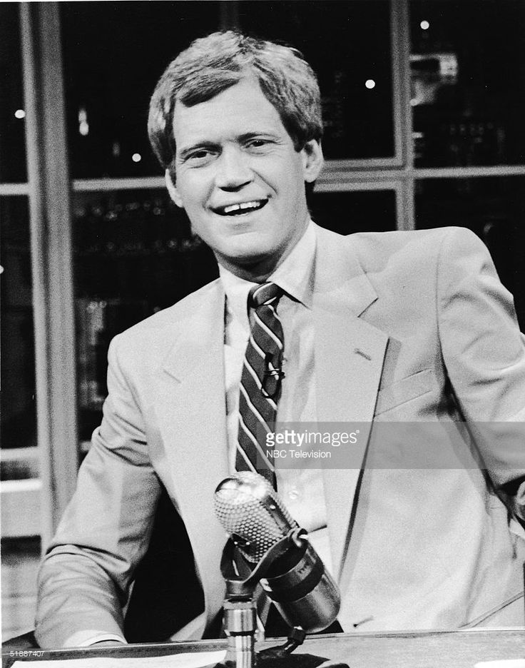 American talk-show host and comedian David Letterman sits at his desk on the television series 'Late Night with David Letterman,' New York, New York, 1986.