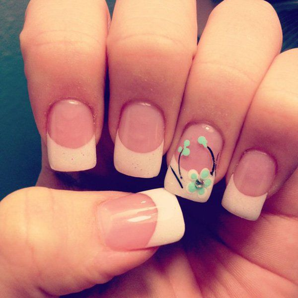 Look at this cheery little French tip! Based with pink polish and tipped thickly in cream, the nails are also accented with a sweet and simple floral design in black and sea green combination.